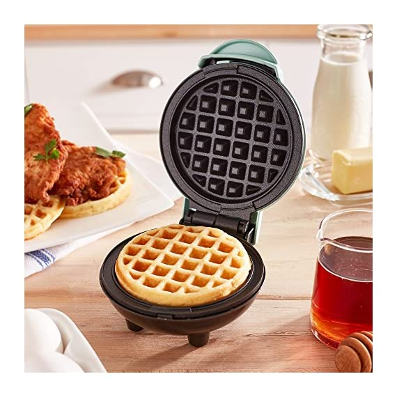 """Dash Mini Maker: The Mini Waffle Maker Machine for Individual Waffles, Paninis, Hash browns, & other on the go Breakfast, Lunch, or Snacks 2 MORE THAN WAFFLES: Make paninis, hash browns, and even biscuit pizzas! Any wet batter will """"waffle"""" your treats and snacks into single serving portions. Great for kids or on the go! COMPACT + LIGHTWEIGHT: Weighing 1lb+, this is a MUST-HAVE for that first apartment, smaller kitchen, college dorm life, or camper/RV traveling QUICK + EASY: Simply plug it in and go; it heats up in mere minutes. The dual non-stick surfaces provide an even cook for consistent results, each and every time"""
