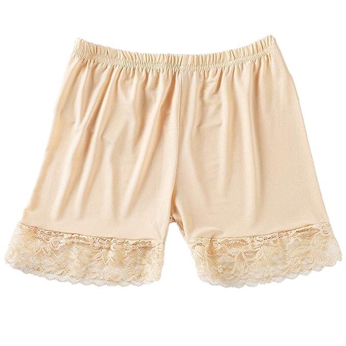 Pantalones Bajo La Falda De Las Mujeres Atractivas Del Cordón Del ...