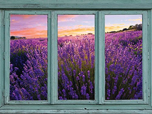 Lavender field in full bloom with a setting sun in the distance Gold Pink and Blue sky Wall Mural