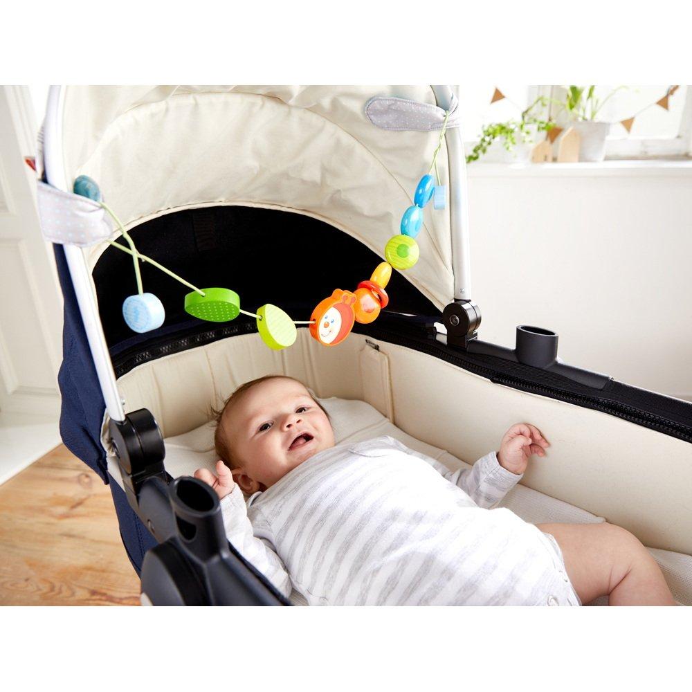Wagenkette mit Holzelementen in Regenbogenfarben und niedlichem Raupenkopf Baby-Spielzeug f/ür den Kinderwagen Kinderwagenkette Raupe Haba 303756