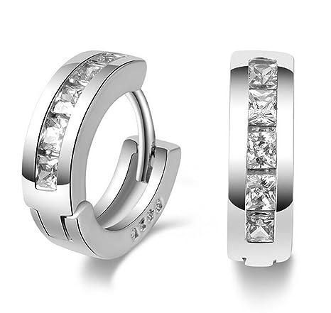 bd6d265f9566 Xuxuou 1 par de aretes sencillos redondos de moda suizo de diamantes  pendientes de diamantes europeos