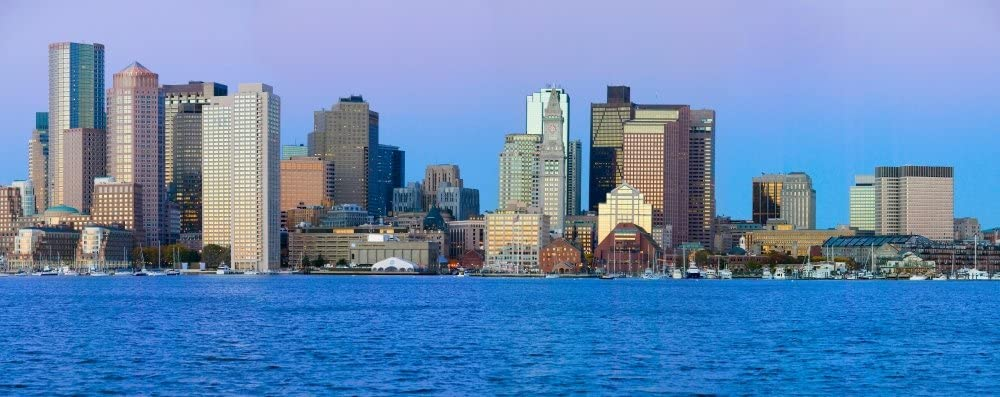 Panoramic of Boston Harbor and the Boston skyline at sunrise as seen from South Boston Massachusetts New England Poster Print by Panoramic Images (15 x 6)