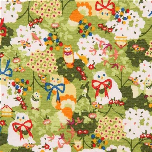- lime green Japanese canvas fabric with animals, Design: Kayo Horaguchi (per 0.5 yard unit)