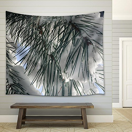 Closeup to Pine Branch Covered with Snow Fabric Wall Tapestry