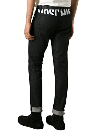 a45689e4e7db7 Moschino Couture Slim Fit Jeans with Back Logo (54) at Amazon Men's ...