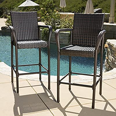 "Christopher Knight Home 295946 Stewart Outdoor Bar Stool, Set of 2, Brown - Hand Woven Wicker: This hand-woven Polyethylene wicker outdoor bar stool is constructed for years of use. It is powder coated Steel frame for superior rust resistance. These bar stools 30 inches seat height are ideal for your patio. Dimensions 46.50""High x 24.35""Wide x 24.80""Deep. Seat Height 30 Inches. Weather Resistant: Our checkered wicker outdoor bar height chairs are stylish and functional. Able to withstand a wide range of climates. Our wicker is tough and weather resistant as well. It's a must-have bar furniture to get a beautiful outdoor experience. Superior Comfort: These bar height patio chairs are super comfortable, sturdy and can be carried easily. The built-in footrest of these outdoor wicker chairs is stable enough which provides a comfortable place to rest your feet so that you can enjoy your leisure time more relaxed. - patio-furniture, patio-chairs, patio - 617 gHSLzML. SS400  -"