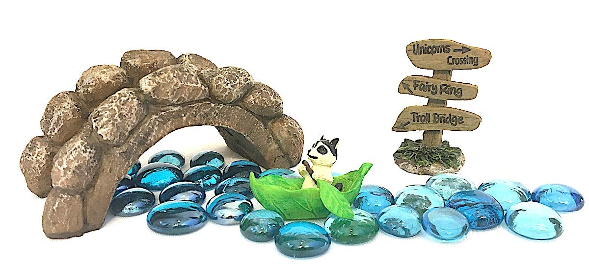 Miniature Raccoon in a Leaf Rowboat, Blue Gems for Stream, Stone Look Troll Bridge and Brown resin wood sign stating ''Unicorns Crossing, Fairy Ring, and Troll Bridge'' in black lettering. by Snickerdoodle Smalls