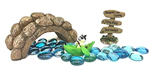 """Miniature Raccoon in a Leaf Rowboat, Blue Gems for Stream, Stone Look Troll Bridge and Brown resin wood sign stating """"Unicorns Crossing, Fairy Ring, and Troll Bridge"""" in black lettering."""