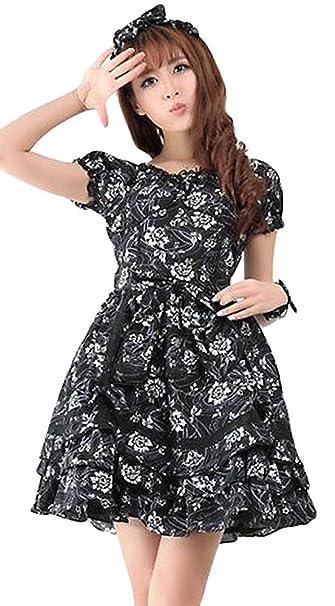 fe4e83b10679 Vestito nero a motivo floreale bianco con fiocco