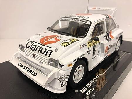 Sunstar - 5536 - MG Metro 6R4 - Rally de los 1000 Lagos 1986 - Escala 1/18 - Color Blanco: Amazon.es: Juguetes y juegos