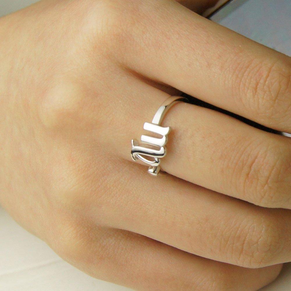 情侣带什么戒指好_情侣款陶瓷男士戒指女
