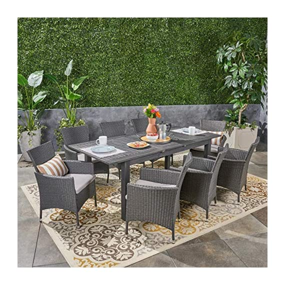 Great Deal Furniture Austin Outdoor 9 Piece Wood and Wicker Expandable Dining Set, Dark Gray and Gray and Silver - If you're going to invest in a fine place for you and your loved ones to dine outdoors, you may as well allow room for your family to grow. This expandable dining set seats eight and the adjustable table allows you to customize its dimensions to accommodate not only new friends and relatives but also larger meals and other activities that may call for just a bit more space. Includes: One (1) Dining Table and Eight (8) Chairs. Table Material: Acacia Wood. Chair Material: Polyethylene Wicker. Chair Frame Material: Iron. Cushion Material: Water Resistant Fabric. Composition: 100% Polyester. Table Finish: Gray. Wicker Finish: Dark Gray. - patio-furniture, dining-sets-patio-funiture, patio - 617bJeakcHL. SS570  -