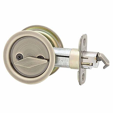 Kwikset 335 Round Bed/Bath Pocket Door Lock in Antique Brass - Kwikset 335 Round Bed/Bath Pocket Door Lock In Antique Brass