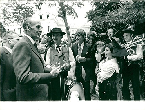 National Costumes Of France (Vintage photo of French President Giscard D'Estaing in the Park de L'Elysee celebrating gambling people in folklore costumes on France's national day)