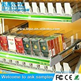 Cigarette pack pusher tray