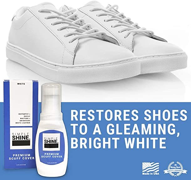 scuffed white leather shoes