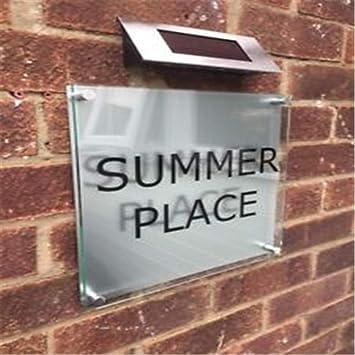 Placa de dirección de la casa con número de letrero de calle ...
