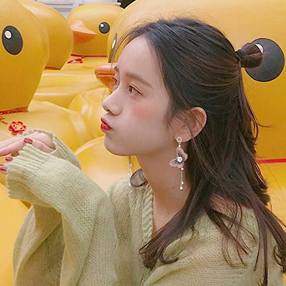 3681aff594bc plata ZQ Pendientes Sencillos con Personalidad De Coreanos Pendientes  Colgantes Largos Salvajes De Mariposa  Amazon.es  Hogar