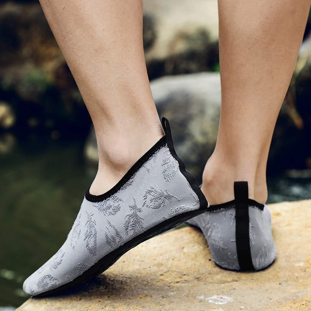 DOLDOA Chaussures de Plage Homme de Couleur Unie Chaussures Aquatiques Homme Femme de Nager Chaussettes de plong/ée de Noir Chaussures Wading