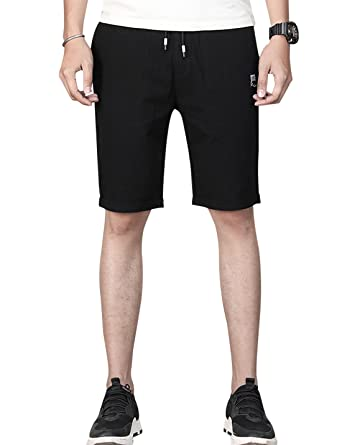 2adb20084d6 Uaneo Men s Fashion Casual Sports Shorts Knee Length Elastic Waist Loose  Half Pants Beach Trunks Trousers at Amazon Men s Clothing store