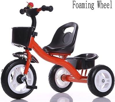 niño interior al aire libre el pequeño triciclo bicicleta Bicicleta de ...