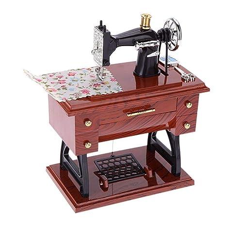 ASGHSA Pedal Retro Mini máquina de Coser Caja de música Cuerda Manual Caja de música Mini Regalo de cumpleaños Estilo Personalidad Juguete Musical, 17 * 9 * 20 CM: Amazon.es: Hogar