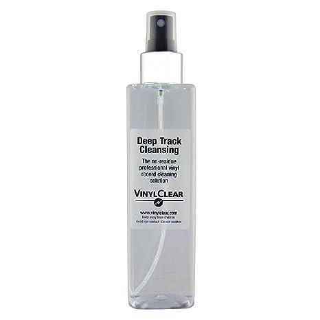 Botella con atomizador con fluido limpiador para restauración de ...