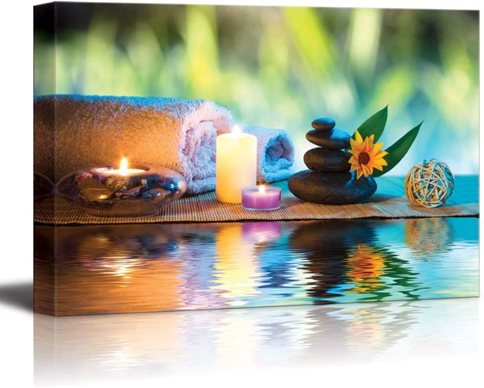 """Canvas Prints Wall Art - Three Candles and Towels with Black Zen Stones and Orange Daisy on Water Spa/Wellness/Beauty Concept 