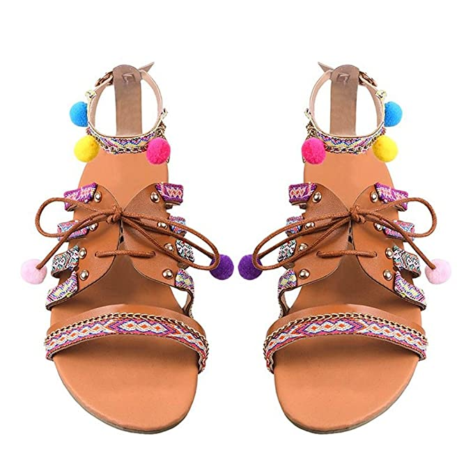e263d30a1 Amazon.com  Inverlee Women Bohemia Sandals Gladiator Leather Sandals Flats  Shoes Pom-Pom Sandals  Clothing