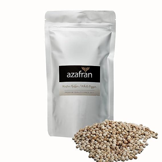 Bio de molinillos de color blanco (granos de pimienta Ganz) y pimienta Adecuado –