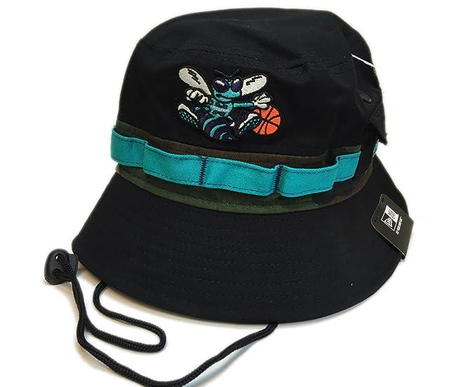 71342efce466b7 Amazon.com: New Era Camo Band Bucket Cap Charlotte Hornets: Clothing