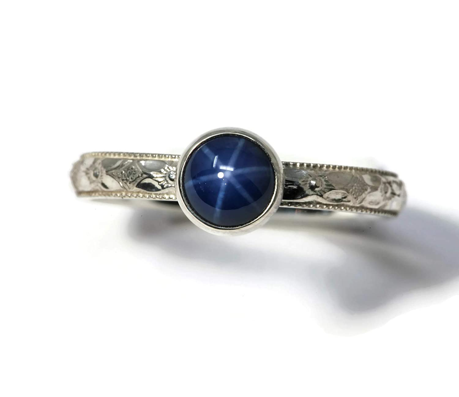 6mm Created Blue Star Sapphire and Sterling Silver Ring on Symmetrical Flower Pattern Band