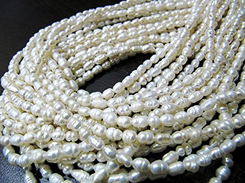 Rice Pearl Beads 5 to 7mm long and approx. 4mm wide, Fresh Water Natural Pearl Strands 13.5inch Long, Wholesale rates, Bulk Pricing options -