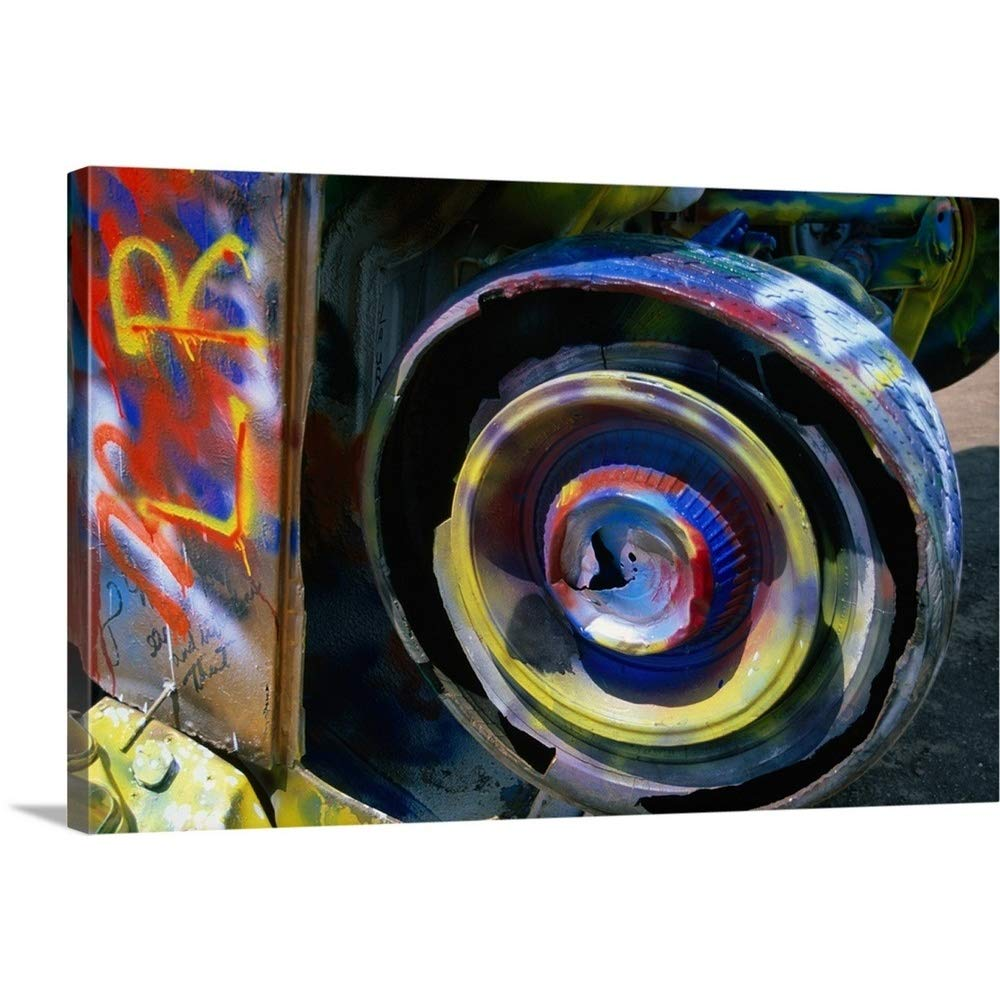 """GREATBIGCANVAS Gallery-Wrapped Canvas Entitled Wheel of a Half-Buried Cadillac Covered in Graffiti, Cadillac Ranch Monument. by 18""""x12"""""""
