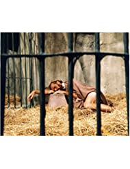 Charlton Heston 8 inch by 10 inch PHOTOGRAPH Planet of the Apes The Ten Commandments Ben-Hur from Ankles Up Lying on Hay in Cell kn