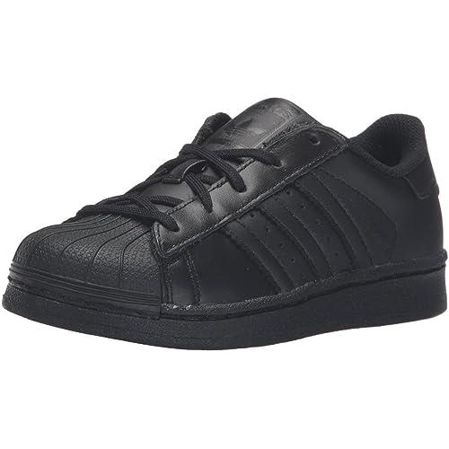 timeless design ac26b 44843 adidas Superstar C, Zapatillas de Gimnasia Unisex Niños  Amazon.es  Zapatos  y complementos