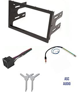 asc audio car stereo dash pocket kit, wire harness, antenna adapter, and  radio