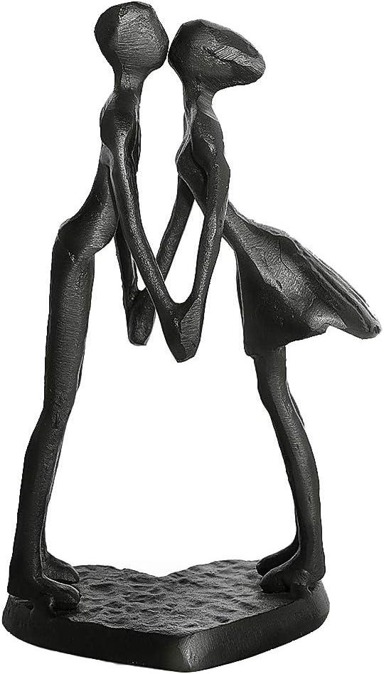 ejemplo de escultura de pareja besandose