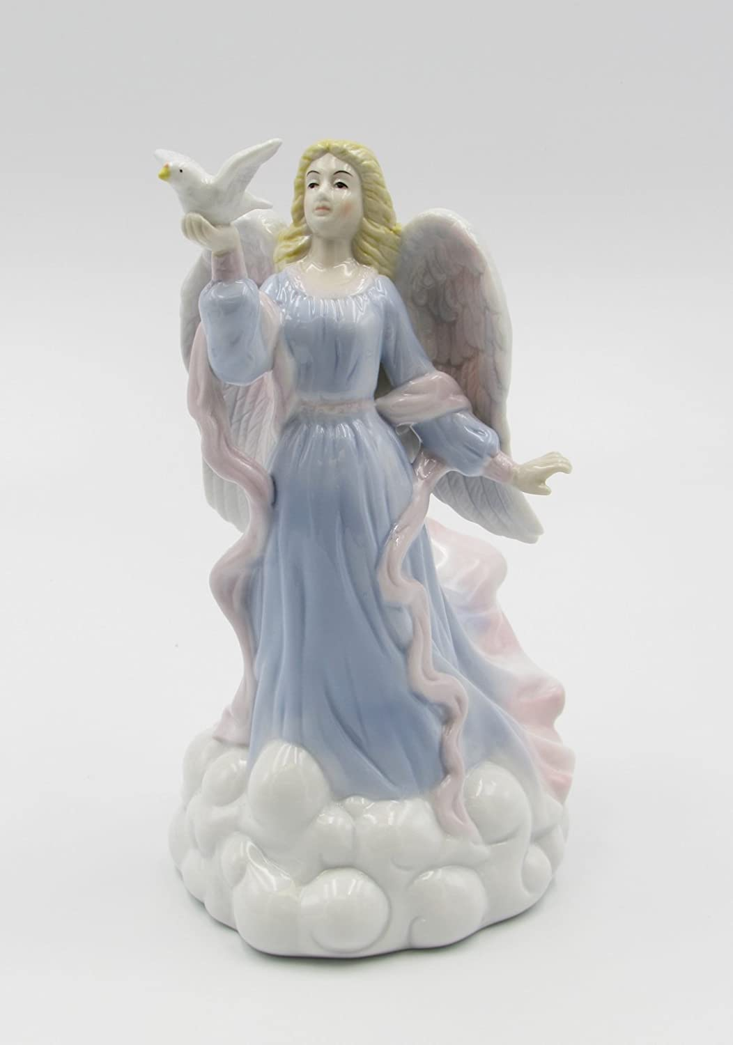 Amazon Com Cosmos Gifts 1334 Fine Porcelain Inspirational Peace Angel Holding Dove Music Box Figurine Tune Wind Beneath My Wings 8 H Home Kitchen