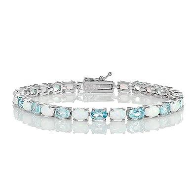 0f8871984ff95 Amazon.com: Glitzs Jewels Sterling Silver Blue Topaz and Simulated ...
