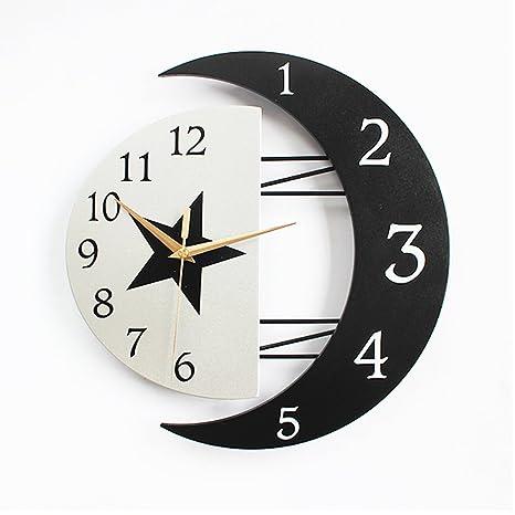 c3932f686374 Blanco y negro La luna Reloj de pared Personalidad Creativo Reloj de cuarzo Decoración  Reloj de