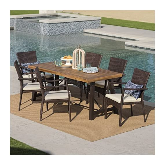 "Christopher Knight Home Playa | Outdoor 7-Piece Wood/Wicker Dining Set with Water Resistant Cushions | in Brown/Teak Finish/Cream - This clean and simple dining set combines the functionality of wood and iron with the comfort of wicker. Complete with a table, and 6 wicker dining chairs, this set offers comfortable seating in the great outdoors. Sure to complement any patio decor, this dining set offers you a stylish wooden design with the functionality of an iron framework and comfortable wicker chairs, guaranteed to give you a weather resistant set that will last your for years to come. Includes: One (1) Dining Table and Six (6) Chairs Table Dimensions: 70.00""L x 33.00""W x 29.50""H 