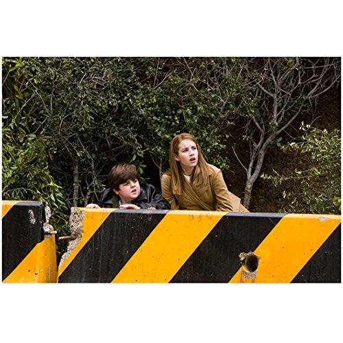 Nancy Drew Josh Flitter and Emma Roberts behind yellow and black guardrail in front of bushes 8 x 10 Inch - Pictures Guardrails Of