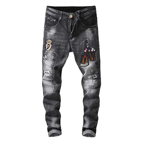 Los Pantalones Vaqueros Micro-Elásticos Del Paño Del Parche ...