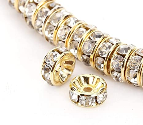A glass gold//silver rhinestone rondelle spacer beads in sizes and colours