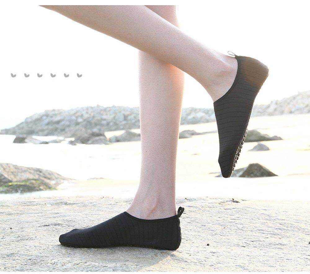 big sale 6a19c 09753 COMAMUY Zapatos de agua unisex Zapatos de piel descalza para buceo Surf  Swim Beach Yoga Negro