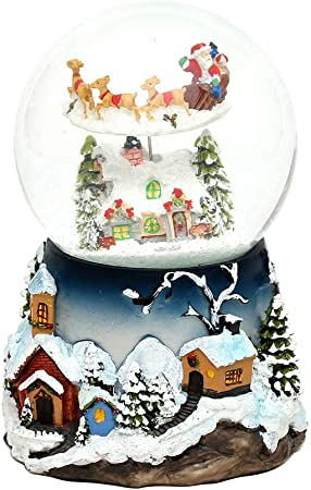 Mágica Bola de Nieve con luces, sonido y movimiento, tamaño aprox. Ø 12 cm: Amazon.es: Hogar