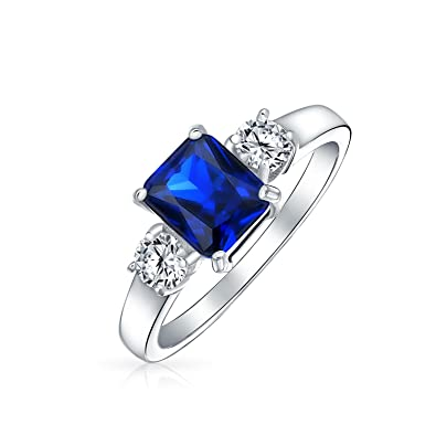 0a866c56088be7 Bling Jewelry Sterling Silver 1.5 ct Emerald Cut Blue Sapphire Color CZ Three  Stone Engagement Ring