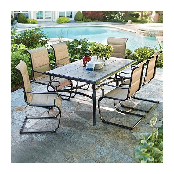 Belleville 7-Piece Padded Sling Outdoor Dining Set - Includes 39.5 in. x 64 in. table and 6 padded sling motion chairs Bronze powder-coated frames & sling fabric are weather-resistant Heavy-duty ceramic tile tabletop is durable and easy to clean - patio-furniture, dining-sets-patio-funiture, patio - 61Au4l0KccL. SS570  -