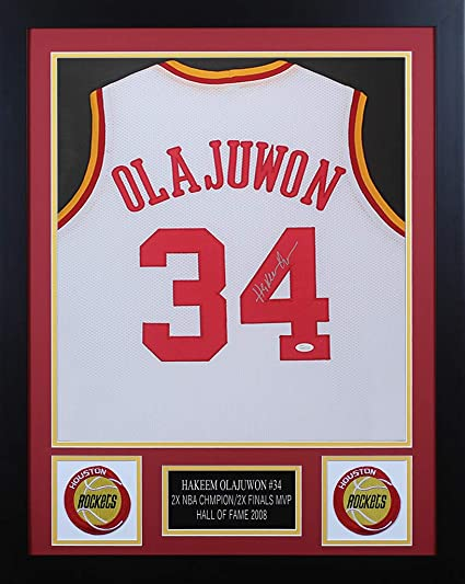 4818a211f Hakeem Olajuwon Autographed White Rockets Jersey - Beautifully Matted and  Framed - Hand Signed By Hakeem